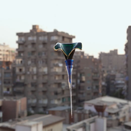 Hassan Khan, A glass object photographed as a way of collecting the world around it, 2013. photographic print on paper, 40 x 40 cm  © Courtesy of the artist and Chantal Crousel